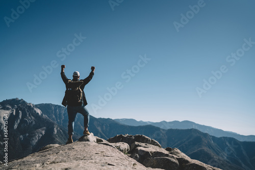Freedom concept of male explorer excited with getting to mountain top achievemen Wallpaper Mural