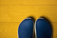 Summer Rubber Shoes On Yellow ...