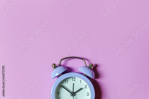 Obraz Simply minimal design ringing twin bell vintage classic alarm clock Isolated on purple violet background. Rest hours time of life good morning night wake up awake concept Flat lay top view copy space - fototapety do salonu