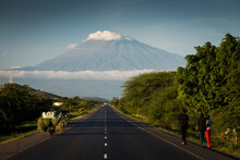 A Road With Mount Meru In Back...