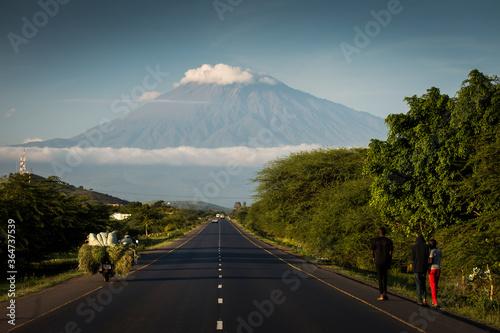 Obraz A road with Mount Meru in background, Tanzania. - fototapety do salonu