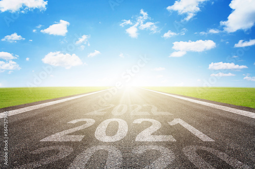 Fotografiet Asphalt road with arrow guideline and 2021 letters painted on the surface