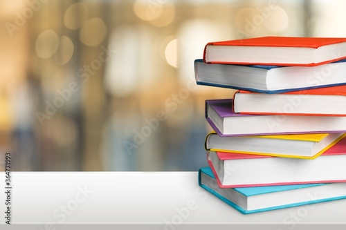 Stack of colorful books collection on the desk Fototapet