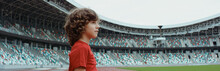 Cute Little Kid Boy Soccer Player Standing On An Empty Stadium, Dreaming Of Becoming Professional Player, Soccer Star