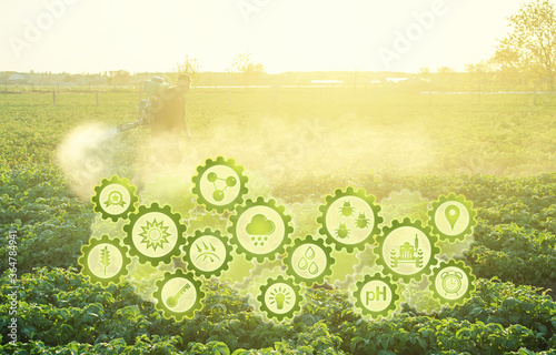 Photo Futuristic innovative technology gears and a farmer processing a potato plantation with a sprayer