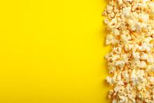 Tasty Popcorn On Yellow Backgr...