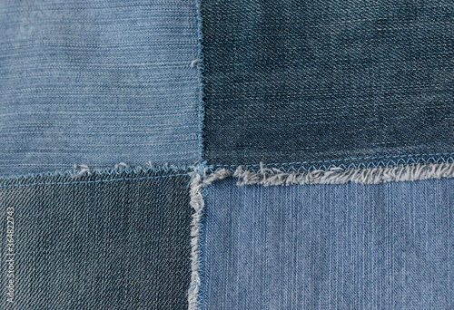 Slika na platnu Old denim jeans texture or background made from different colored jeans peaces