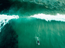 Aerial View Of A Surfer Lying ...