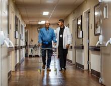 Male Nurse Assisting Senior Ma...
