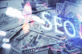 Fototapeta Kawa jest smaczna - Double exposure of seo drawing over us dollars bill background. Concept of search optimization.
