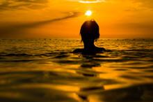 Girl Swimming In The Sea At Su...