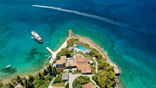 Aerial Drone Photo Of Hinitsa Bay A Popular Anchorage Crystal Clear Turquoise Sea Bay For Yachts And Sail Boats Next To Porto Heli, Saronic Gulf, Greece