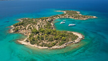 Aerial Drone Photo Of Hinitsa Bay A Popular Anchorage Crystal Clear Turquoise Sea Bay For Yachts And Sailboats Next To Porto Heli, Saronic Gulf, Greece