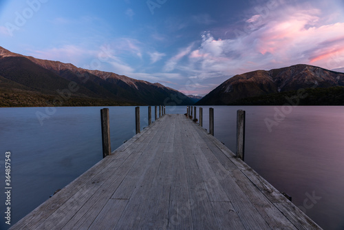 Sunset at they jetty at  Lake Rotoiti in Sant Arnaud in the South Island of New Wallpaper Mural