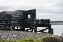 Okarito Wharf And Boat Shed On The West Coast Of New Zealand