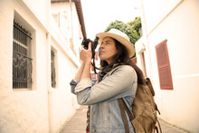 Woman Visiting Town Taking Pic...