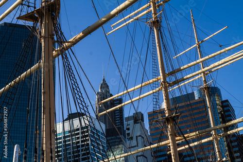 Fotografie, Tablou The Skyline of Lower Manhattan Through Ships Mast, New York, New York, USA