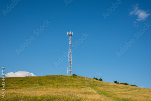 Photo Mobile transmitter on a green hill
