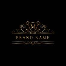 M Premium Luxury Gold Monogram Logo. M Letter Logo. M Monogram Luxury Gold Logo.