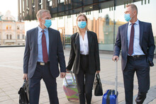 Business Tourists In Face Mask...
