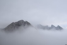 View Of A Mountain With Clouds...