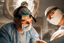 2 Surgeons With Headlamp Do Pl...