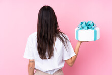 Young Woman With A Big Cake Ov...