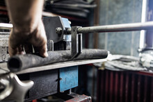 Worker, Cutting Hydraulic Hose...