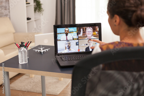 Woman in a video call with business partners using tablet computer.