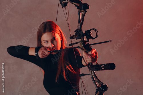 Vászonkép Archer woman with sport bow and arrow.