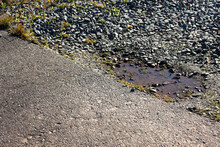 Pothole Next To The Road