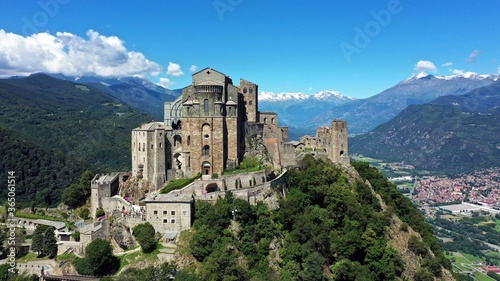 Slika na platnu The Sacra di San Michele (Saint Michael's) Abbey, Turin, Italy, shot aerial with mountains of Susa valley in background