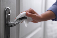 Woman Cleaning Door Handle Wit...