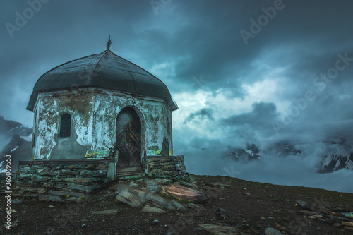 Fototapeta ruins of the mausoleum on the top of the mountain alps Austria just before heavy