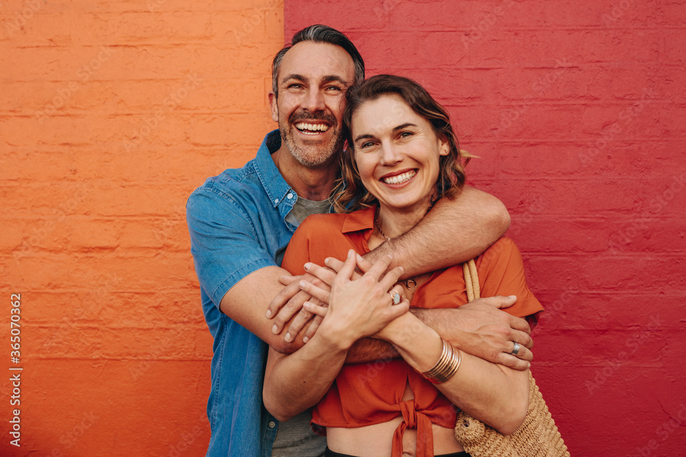 Fototapeta Affectionate couple embracing each other