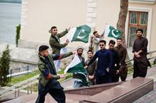 Group Of Pakistani Man Wearing Traditional Clothes Salwar Kameez Or Kurta With Pakistan Flags.
