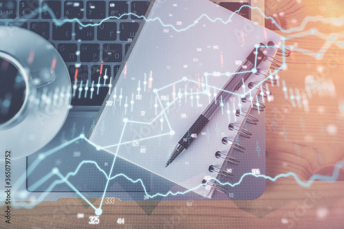 Multi exposure of forex chart drawing and work table top veiw Canvas Print
