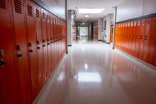 Empty Hallway In School Lined With Orange Lockers