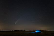 C / 2020 F3 Comet (NEOWISE) In The Evening Sky. Camping Under The Starry Sky, Where There Is A Bright Comet And A Tail Between The Stars. Photographed In Hungary On July 14, 2020.