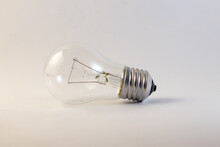 Old Incandescent Bulb Lies On A White Background