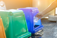 Close-up: A Woman Throwing Tissue In To A Recycle Bin.