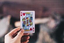 Close-up Of Hand Holding King Card