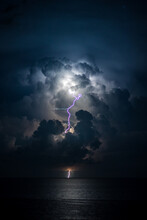 Scenic View Of Sea Against Sky During Store And Lightning Strike