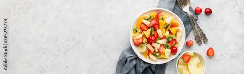 Fototapeta Fresh chopped fruit salad in a bowl. Long banner format. obraz