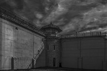 Kingston Penitentiary At Night Inside Prison Yard Moonlight High Stone Walls Barbed Wire And Guard Tower Nobody
