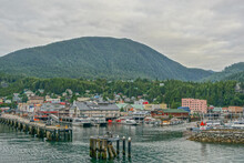 Ketchikan, Alaska: Shops At The Harbor Await The Arrival Of Tourists, With A Forest-covered Mountain In The Background.