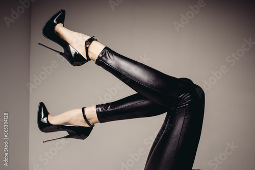 Slender female legs in spandex catsuit and a fetish shoe with extremely high heels Fototapet
