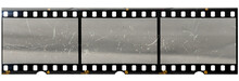 Original 35mm Filmstrip With Empty Dusty Frames Or Cells And Nice Texture On The Border, Fluffs On Film Material, Real Film Grain.