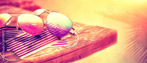 Fototapeta Sunglasses with Coronavirus mask on the beach obraz