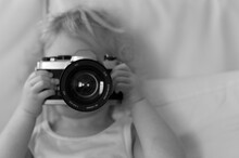 Little Blonde Girl Shooting With Single Reflex Camera